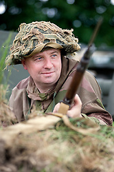 "A re-enactor from the Northern World War Two Association Living History group portrays a member of the British 5th Battalion, East Yorkshires, 50th Division complete with classic Brodie ""tin helmet"" Lee Enfield Rifle and fixed Bayonet. SPAM 1940's Weekend Heckmonwyke near Wakefield 10 July 2010 .Images © Paul David Drabble."