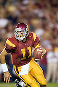 University of Southern California Trojan quarterback Matt Leinart scrambles with the ball looking to pass during a 70 to 17 win over the Arkansas Razorbacks on September 17, 2005 at Los Angeles Memorial Coliseum in Los Angeles, California. .Mandatory Credit: Wesley Hitt/Icon SMI