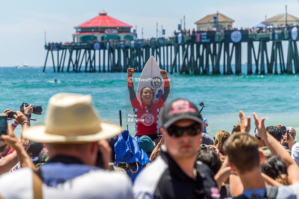HUNTINGTON BEACH, CA - Pro Surfer Johanne Defay (FRA) claimed her first elite CT victory today, taking out Sally Fitzgibbons (AUS) in a tense Final at Huntington Beach Pier. The win sees her earn 10,000 points and move up five places to sixth on the Jeep Leaderboard. The Reunion Island surfer took an early opportunity in the Final and earned a heat-high 7.67 for a series of backhand snaps to take the lead and put the pressure on Fitzgibbons, who was left looking for a 5.52. Fitzgibbons found a comeback wave with five minutes remaining, showcasing a reverse followed by two more turns. She was rewarded with a 7.00 and the lead but Defay answered with two big turns for 5.87 and reclaimed the top spot to take the win. 2015 Aug 2.  Byline, credit, TV usage, web usage or linkback must read SILVEXPHOTO.COM. Failure to byline correctly will incur double the agreed fee. Tel: +1 714 504 6870.