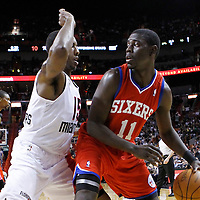 21 January 2012: Miami Heat point guard Mario Chalmers (15) defends on Philadelphia Sixers point guard Jrue Holidays (11) during the Miami Heat 113-92 victory over the Philadelphia Sixers at the AmericanAirlines Arena, Miami, Florida, USA.