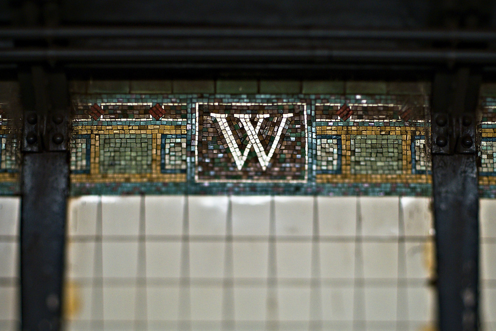Letter W in mosaic on wall of Wall Street subway station, lower Manhattan, New York, NY, US