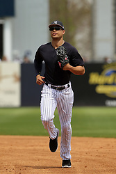 March 18, 2018 - Tampa, FL, U.S. - TAMPA, FL - MAR 18: Giancarlo Stanton (27) of the Yankees trots off the field between innings during the game between the Miami Marlins and the New York Yankees on March 18, 2018, at George M. Steinbrenner Field in Tampa, FL. (Photo by Cliff Welch/Icon Sportswire) (Credit Image: © Cliff Welch/Icon SMI via ZUMA Press)