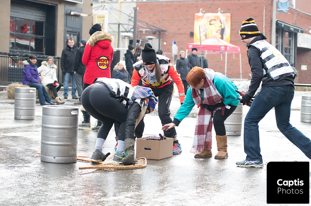 People pick up bottles during a winter themed bar-back competition. Staff from bars around the ByWard Market went head to head in the competition. January 31, 2016. Brendan Montgomery/Captis Photos