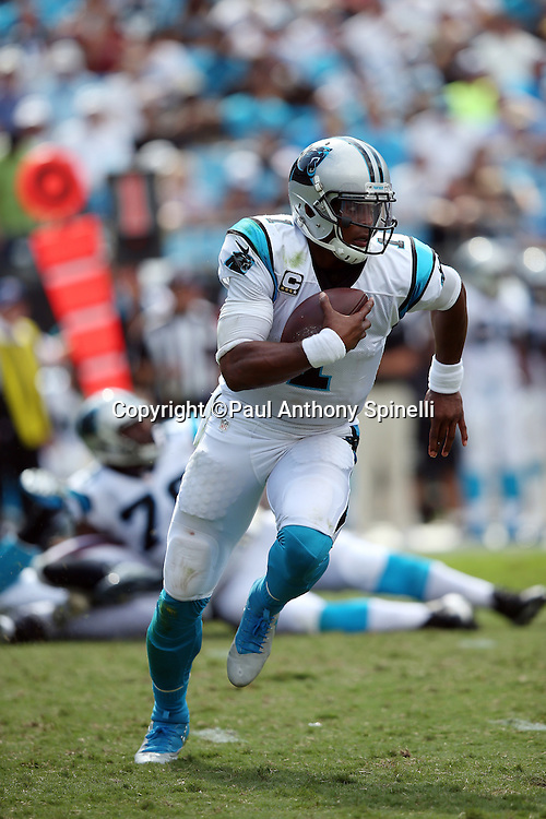 Carolina Panthers quarterback Cam Newton (1) runs the ball for a gain of 19 yards and a first down in the third quarter during the 2015 NFL week 2 regular season football game against the Houston Texans on Sunday, Sept. 20, 2015 in Charlotte, N.C. The Panthers won the game 24-17. (©Paul Anthony Spinelli)