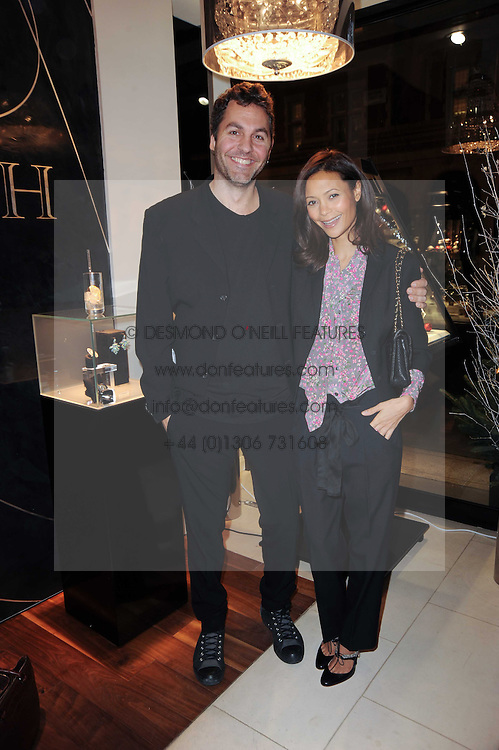 THANDIE NEWTON and OL PARKER at a party for TACH jewellery held at Tach, 13 Grafton Street, London on 10th December 2009.