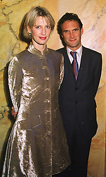 MISS NICOLA FORMBY and MR A A GILL the journalist,  at a party in London on 7th December 1998.MMT 98
