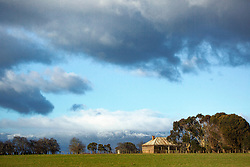 A rustic weatherboard farm building near Bishopsbourne  in Tasmania's northern midlands.