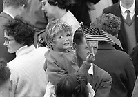 95324<br /> <br /> American President John Fitzgerald Kennedy (J.F.K.)'s visit to Ireland June 1963.<br /> A young child in adult's arms, holding aloft an American flag.<br /> (Part of the Independent Newspapers Ireland/NLI collection.)