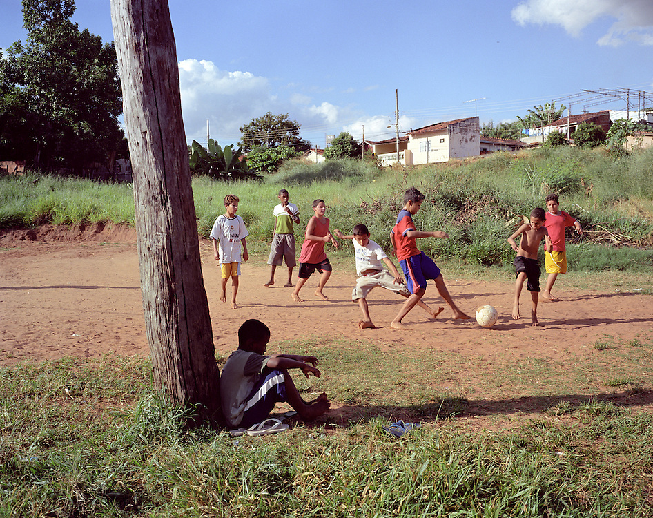 Boys play football barefoot in Bauru, where the soccer legend Pelé grew up and played football as a child.