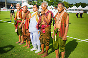 "28 AUGUST 2014 - BANGKOK, THAILAND:     A Brahmin priest, center, with ""Khru Ba Yai,"" or Elephant Spirit Men, participate in a blessing ceremony before the King's Cup Elephant Polo Tournament at VR Sports Club in Samut Prakan on the outskirts of Bangkok, Thailand. The tournament's primary sponsor in Anantara Resorts. This is the 13th year for the King's Cup Elephant Polo Tournament. The sport of elephant polo started in Nepal in 1982. Proceeds from the King's Cup tournament goes to help rehabilitate elephants rescued from abuse. Each team has three players and three elephants. Matches take place on a pitch (field) 80 meters by 48 meters using standard polo balls. The game is divided into two 7 minute ""chukkas"" or halves.   PHOTO BY JACK KURTZ"