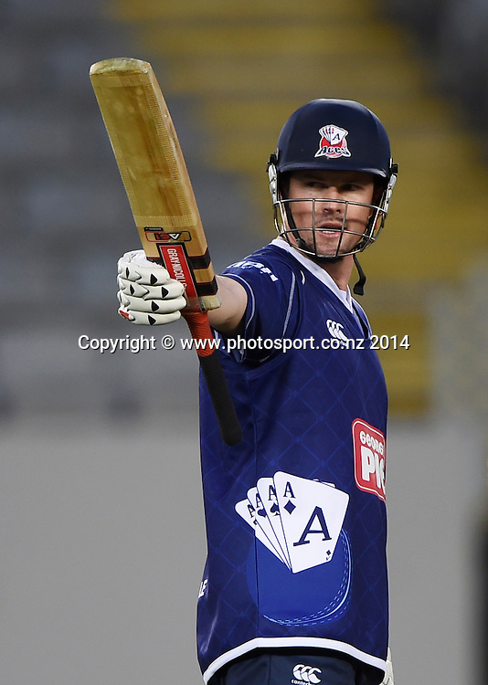 Colin Munro celebrates his 50 for Auckland during the Georgie Pie Super Smash Twenty20 cricket match between the Auckland Aces and Wellington Firebirds at Eden Park, Auckland on Friday 14 November 2014. Photo: Andrew Cornaga / www.Photosport.co.nz