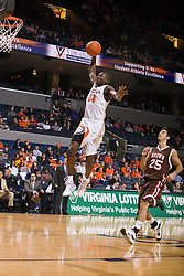 Virginia guard/forward Mamadi Diane (24) skies for a dunk after beating Brown forward Peter Sullivan (25) down the court.  The Virginia Cavaliers defeated the Brown University Bears 74-50 in NCAA Basketball at the John Paul Jones Arena on the Grounds of the University of Virginia in Charlottesville, VA on January 6, 2009.