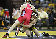 January 22 2010: Iowa's Tony Ramos works against Ohio State's Ian Paddock during the 133-pound bout an NCAA wrestling dual at Carver-Hawkeye Arena in Iowa City, Iowa on January 22, 2010. Ramos defeated Paddock 5-2 and Iowa defeated Ohio State 33-3..