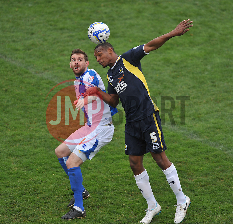 Bristol Rovers' Steven Gillespie battles for a high ball with Torquay United's Krystian Pearce  - Photo mandatory by-line: Alex James/JMP - Mobile: 07966 386802 12/04/2014 - SPORT - FOOTBALL - Bristol - Memorial Stadium - Bristol Rovers v Torquay United - Sky Bet League Two