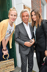Left to right, CHARLOTTE DELLAL, GIANCARLO GIAMETTI and ASTRID MUNOZ at the launch of the new collection from Limoland held at Anderson & Sheppard's Haberdashery, 17 Clifford Street,London on 16th June 2014.