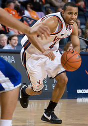 Virginia guard Calvin Baker (4) in action against Hampton.  The Virginia Cavaliers men's basketball team defeated the Hampton Pirates 79-65 at the John Paul Jones Arena in Charlottesville, VA on December 19, 2007.