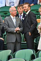 © Licensed to London News Pictures. 02/07/2016. SIR BOBBY CHARLTON and DAVID BECKHAM watch tennis from the Royal Box on the centre court on the sixth day of the WIMBLEDON Lawn Tennis Championships.  London, UK. Photo credit: Ray Tang/LNP