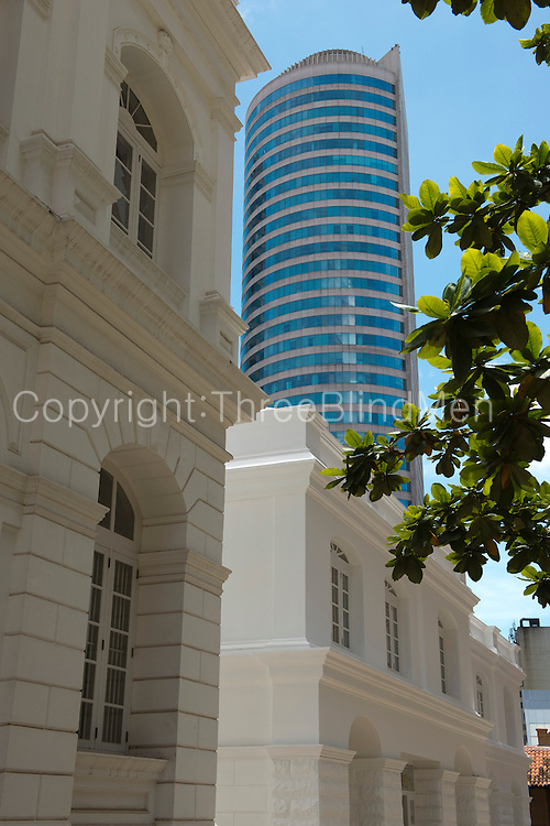 Looking through old restored colonial buildings in Colombo Fort towards the World Trade Centre tower in the City.