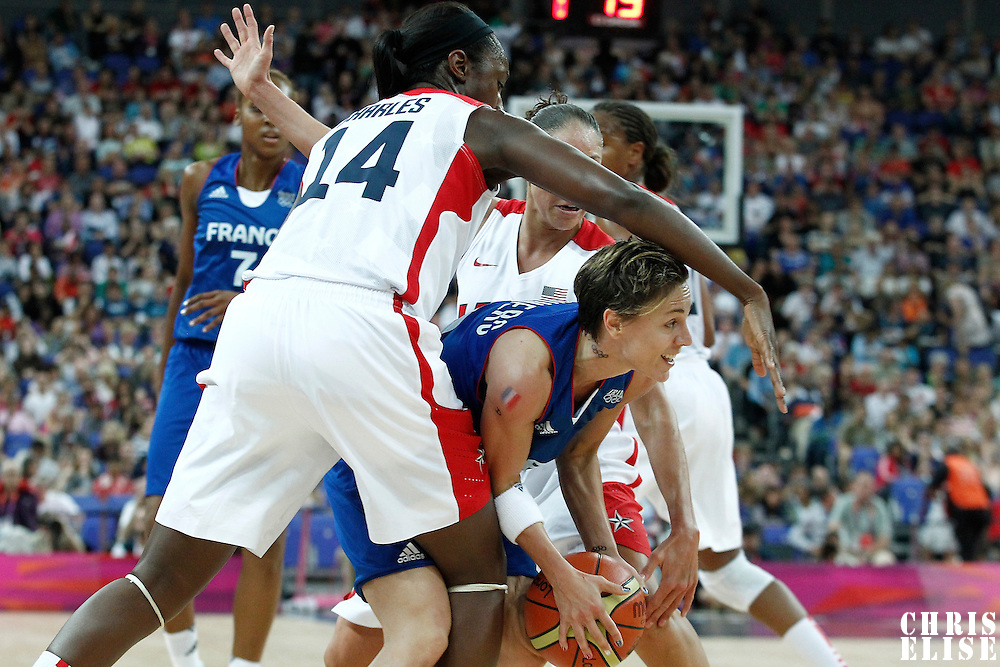 11 August 2012: France Celine Dumerc is double-teamed during 86-50 Team USA victory over Team France, during the Women's Gold Medal Game, at the North Greenwich Arena, in London, Great Britain.