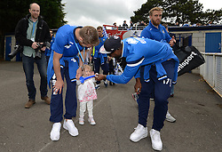 Bristol Rovers' Ellis Harrison gives a gift to Bristol Rovers' Lee Brown's daughter - Photo mandatory by-line: Dougie Allward/JMP - Mobile: 07966 386802 - 25/05/2015 - SPORT - Football - Bristol - Bristol Rovers Bus Tour