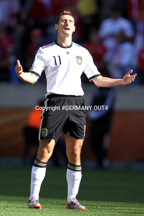 Miroslav Klose of Germany  shows his frustration at getting a yellow card during the FIFA World Cup 2010 South Africa pool match between Germany and Serbia held at The Nelson Mandela Bay Stadium in Port Elizabeth, South Africa on the 18th June 2010<br /> <br /> Photo by Ron Gaunt/SPORTZPICS<br /> <br /> #GERMANY OUT#