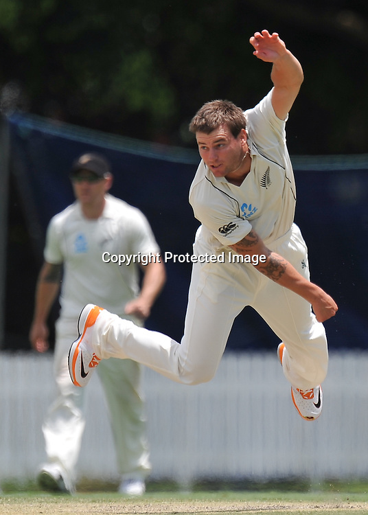 Doug Bracewell follows through while bowling from the Crosby Road end during action from Day 3 of the Tour match between Australia A and New Zealand played at Allan Border Field from 24th - 27th November 2011~ Photo Credit Required : Steven Hight (AURA Images) ~ Editorial Use only in accordance with CA Terms & Conditions (2011-12)
