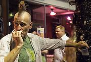 Satchmo Strut 2009; Frenchmen Street; New Orleans; Man with mohawk smoking