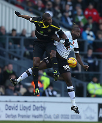 Sheffield Wednesday's Réda Johnson and Derby County's Simon Dawkins battle for an aerial ball -Photo mandatory by-line: Matt Bunn/JMP - Tel: Mobile: 07966 386802 09/11/2013 - SPORT - FOOTBALL - Pride Park - Derby - Derby County v Sheffield Wednesday - Sky Bet Championship