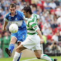 St Johnstone v Celtic...Scottish Cup Semi-Final...14.04.07<br /> Peter MacDonald is blocked by Paul Hartley<br /> <br /> Picture by Graeme Hart.<br /> Copyright Perthshire Picture Agency<br /> Tel: 01738 623350  Mobile: 07990 594431