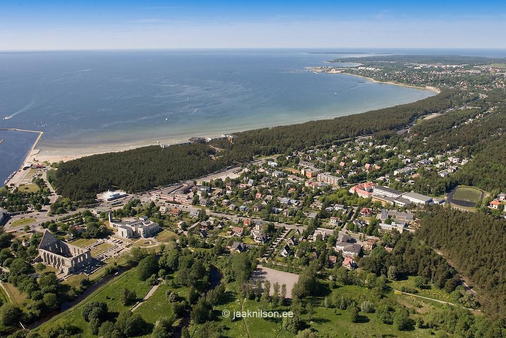 Pirita Beach, Tallinn, Estonia. Baltic Sea. Green Forest with buildings. Waterfront, Coastline, Coast, Aerial View.