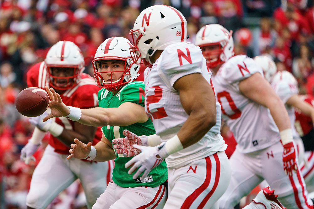 Andrew Bunch #17 pitches the ball to Devine Ozigbo #22 during Nebraska's annual Spring Game at Memorial Stadium in Lincoln, Neb., on April 21, 2018. © Aaron Babcock
