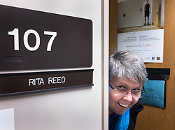 A reception was held for Rita Reed, photojournalism professor at the Missouri School of Journalism, to celebrate her retirement after 16 years of being on the faculty. <br /> <br /> Here Reed poses for a photo outside her office in Lee Hills Hall.<br /> <br /> The event was held on May 10, 2017 in the Cliff and Vi Edom Photojournalism Lab in Lee Hills Hall on the University of Missouri campus in Columbia, Mo.<br /> <br /> The following is from Reed&rsquo;s bio posted on the Missouri School of Journalism website: &quot;Rita Reed joined the photojournalism faculty in 2001 after 20 years as a working photojournalist with Star Tribune in Minneapolis and The Gazette in Cedar Rapids, Iowa. She has worked not only on local, regional and national stories, but also internationally in Haiti, Bolivia, Colombia, Taiwan, China and the countries of the former Eastern Block.<br /> <br /> Reed holds a master&rsquo;s degree in journalism from the University of Missouri and an undergraduate degree from Southwest Missouri State University. She was the 1993 recipient of the Nikon Sabbatical Grant for Documentary Photography for the completion of work on a photographic book about gay and lesbian teenagers. Reed maintains an interest in and concern for adolescents and the issues they face. She is the director of the College Photographer of the Year competition.&rdquo;
