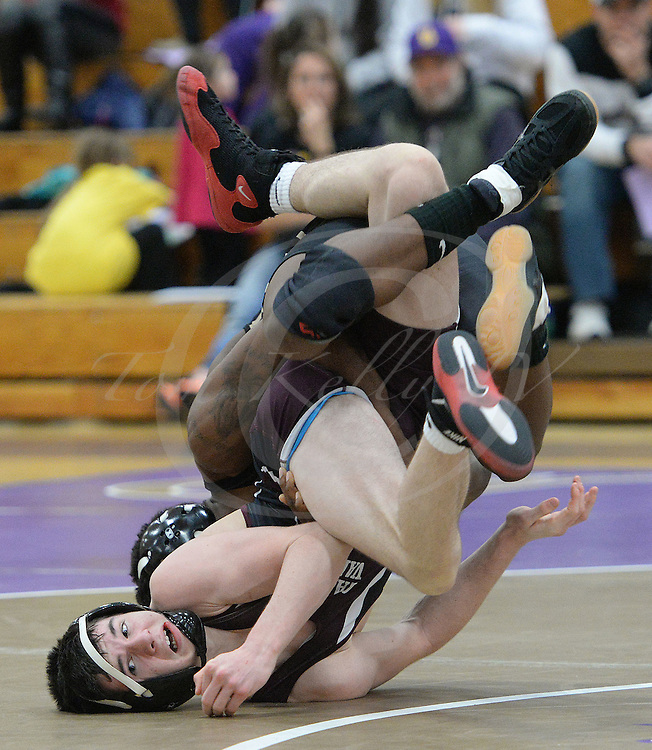 Staff photos by Tom Kelly IV<br /> Garnet Valley's Matt Mortimer takes on Upper Darby's Chris Johnson in the 138 point match, during the Garnet Valley at Upper Darby wrestling match, Wednesday night, February 4, 2015.