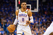 OKLAHOMA CITY, OK - APRIL 21: Russell Westbrook #0 of the Oklahoma City Thunder dribbles down the court during a game against the Portland Trail Blazers during Round One Game Three of the 2019 NBA Playoffs on April 21, 2019 at Chesapeake Energy Arena in Oklahoma City, Oklahoma  NOTE TO USER: User expressly acknowledges and agrees that, by downloading and or using this photograph, User is consenting to the terms and conditions of the Getty Images License Agreement.  The Trail Blazers defeated the Thunder 111-98.  (Photo by Wesley Hitt/Getty Images) *** Local Caption *** Russell Westbrook