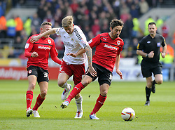 Bristol City's Jon Stead battles for the ball with Cardiff City's Tommy Smith and Cardiff City's Craig Bellamy - Photo mandatory by-line: Joe Meredith/JMP - Tel: Mobile: 07966 386802 16/02/2013 - SPORT - FOOTBALL - Cardiff City Stadium - Cardiff -  Cardiff City V Bristol City - Npower Championship