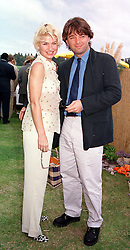 Cabaret star BARONESS ISSY VAN RANDWYCK and her fiance MR EDWARD HALL son of Peter Hall, at a polo match in Sussex on 23rd July 2000.OGI 161