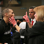 "Juan Castillo gets an after fight checkup after beathing Luis Rodriguez during a ""Boxeo Telemundo"" boxing match at the Kissimmee Civic Center on Friday, July 18, 2014 in Kissimmee, Florida. (AP Photo/Alex Menendez)"