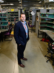 Royal Mail - Courier newspaper | Acute unit lead east Neil Dickinson is one of the many Royal Mail colleague to have benefited from the companies flexible benefits, a scheme called MyBundle.  Pictured is Neil at Beeston Delivery Office, Nottingham.<br /> <br /> Date: February 5, 2018