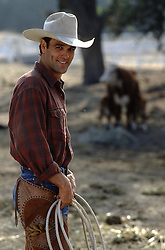 handsome cowboy on a cattle ranch