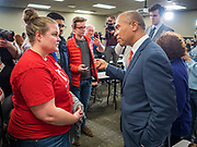 18 NOVEMBER 2019 - DES MOINES, IOWA: Former Governor DEVAL PATRICK (D-MA), right, talks to a Polk County Democrat after the Democrats' November monthly meeting in Des Moines Monday night. Gov. Patrick made his first campaign trip to Iowa Monday after announcing his candidacy to be the Democratic nominee for the US Presidency. His stops included a meeting of the Polk County Democrats in Des Moines. Iowa hosts the first presidential selection event of the 2020 presidential election cycle. The Iowa Caucuses are Feb. 3, 2020.           PHOTO BY JACK KURTZ