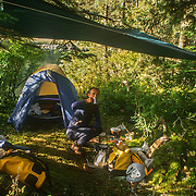 Most of my kayaking and outdoor gear was used for many years, and occasionally, I treated myself to something new like this excellent Sierra Design tent. Most of my kayak dry-bags were well worn and scratched, but as long as I could keep repairing them I carried on using them. One of the biggest culprits for damaging my dry-bags were the pesky squirrels that always knew how to find their favourite snacks, especially peanuts! It was uncanny how they would nibble a hole straight through the coated waterproof fabric and heavy-duty polythene zip-lock bags exactly where their desired morsels were located. My cooking gear was certainly well battered and grubby with carbon, but all of my tatty gear and clothes had served a vital role for many years, and formed part of what was like a friendly family of very familiar objects that accompanied me on all of my epic kayaking trips.