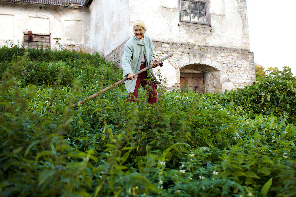 A local lady doing gardening in Lihula