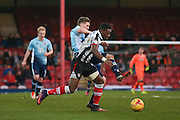 Blackpool midfielder Jim McAlister (4) stops Grimsby Town forward Omar Bogle (9)  during the EFL Sky Bet League 2 match between Grimsby Town FC and Blackpool at Blundell Park, Grimsby, United Kingdom on 31 December 2016. Photo by Simon Davies.