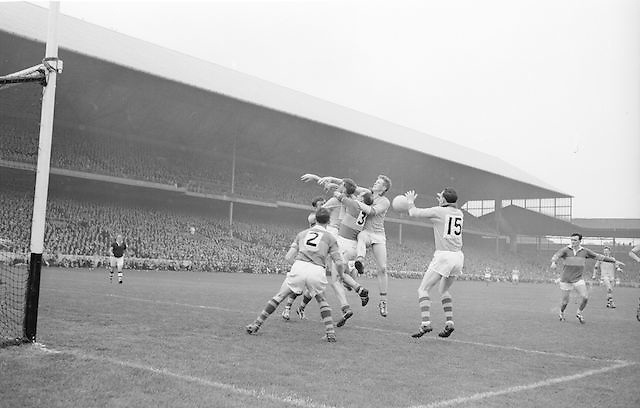 Roscommon's D Feeley gets the ball mid air but Kerry was there to steal the score during the All Ireland Senior Gaelic Football Championship Final Kerry v Roscommon in Croke Park on the 23rd September 1962. Kerry 1-12 Roscommon 1-6.