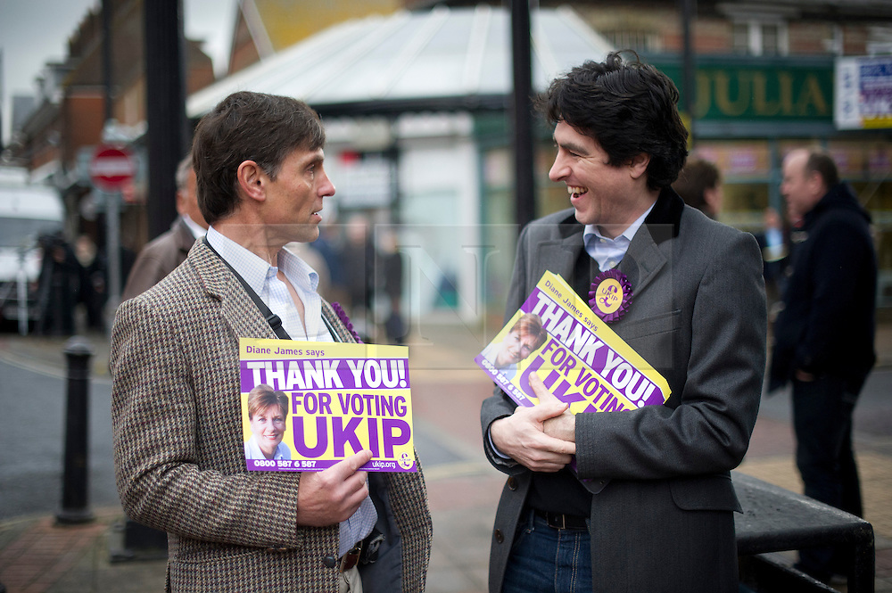 © London News Pictures. 01/03/2013 . Eastleigh, UK.  UKIP (UK INdependence Part) supporters handing out 'Thanks you for voting UKIP' posters in Eastleigh town centre after the party came second in the Eastleigh by-election. Photo credit : Ben Cawthra/LNP