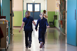 Scenes of  the Santa Rosa French-American Charter School in Santa Rosa,  California .  Two students walk back to their classroom together.