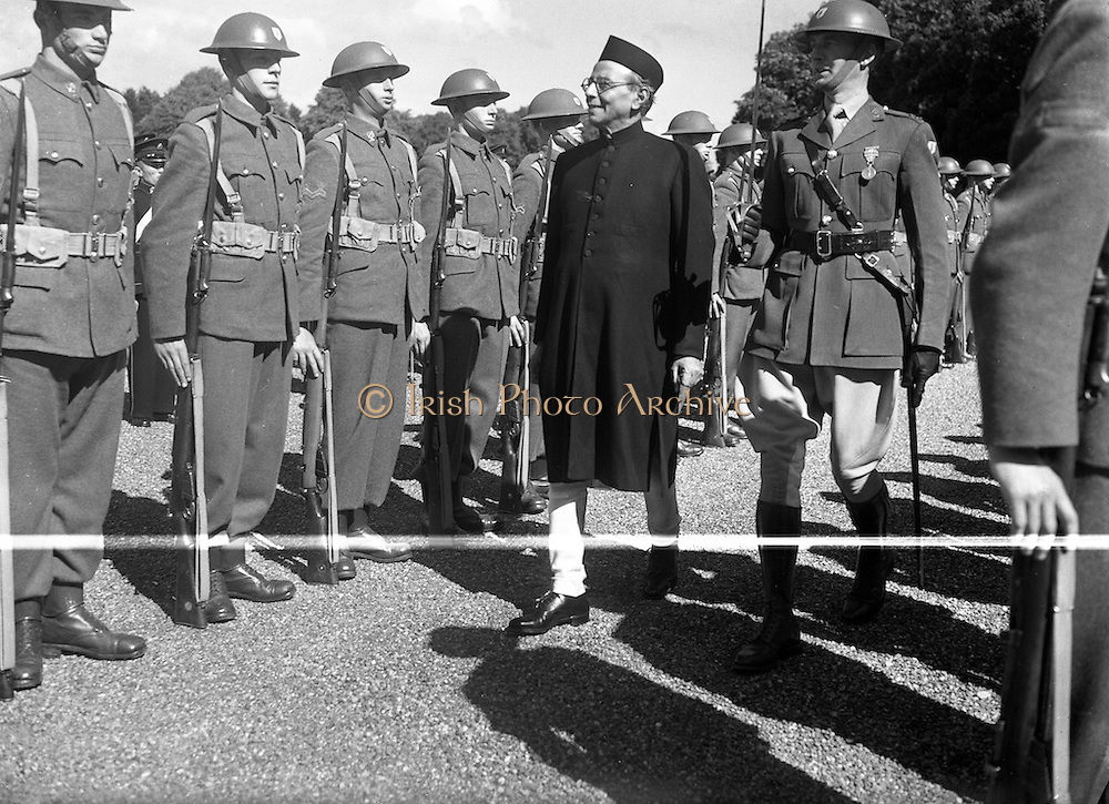12/08/1952<br /> 08/12/1952<br /> 12 August 1952<br /> Mr B.G. Kher, Indian Ambassador to Ireland presents his Credentials to President Sean T. O'Kelly at Aras an Uachtaran. The Ambassador reviews the honour guard.
