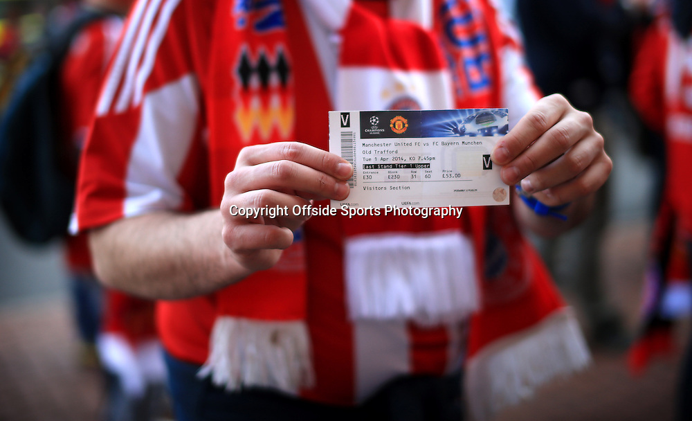 1st April 2014 - UEFA Champions League - Quarter-Final (1st Leg) - Manchester United v Bayern Munich - Bayern fans display their tickets for the game - Photo: Simon Stacpoole / Offside.