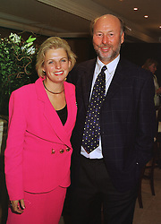 Leading music figure MR CHRIS WRIGHT and his close friend MISS JANICE STINNES at a race meeting in Berkshire on 26th September 1998. MKI 12