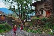 People walking up towards the bus station of Dalgaon village in Spail Valley of Rohru, Shimla, Himachal Pradesh, India